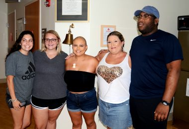 A cancer patient surrounded by her family and friends