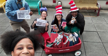 Staff passing out books