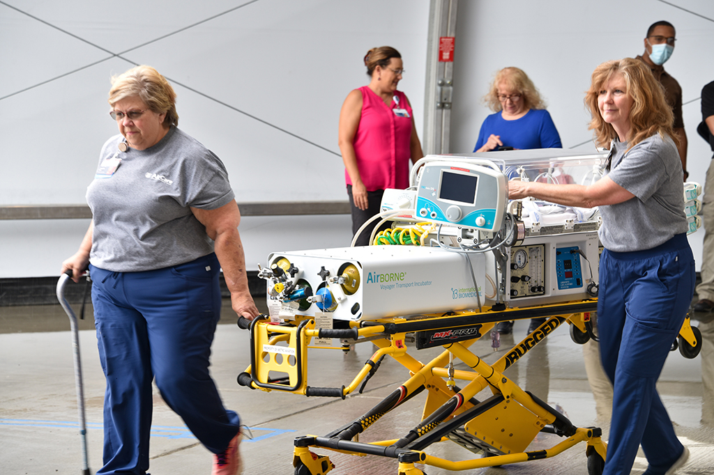 People moving medical equipment