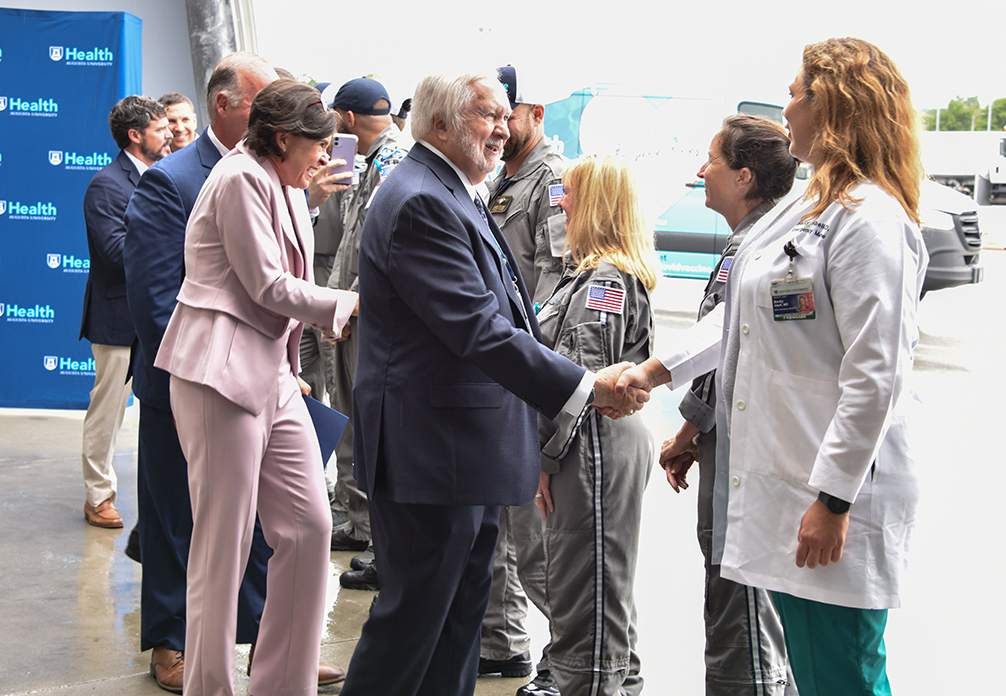 Leadership shaking hands with pilots and nurses